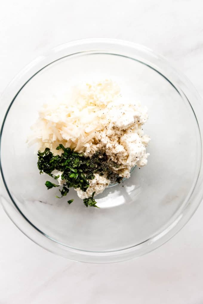 Ricotta, Parmesan and herbs in a mixing bowl