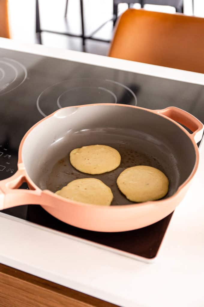 pancakes being cooked in a pan