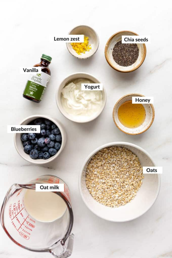 A flat lay of ingredients to make blueberry overnight oats