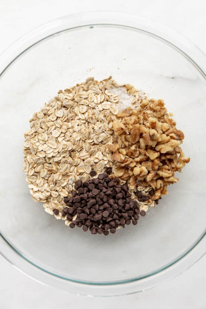 oats, walnuts, chocolate chips and salt in a mixing bowl