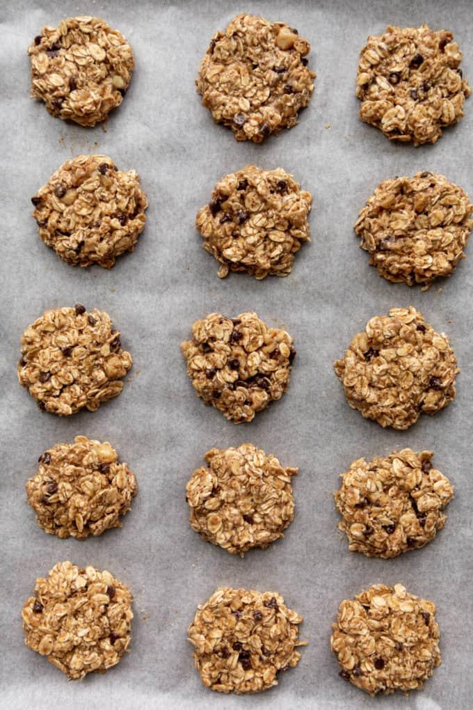 unbaked oatmeal banana cookies on a baking sheet