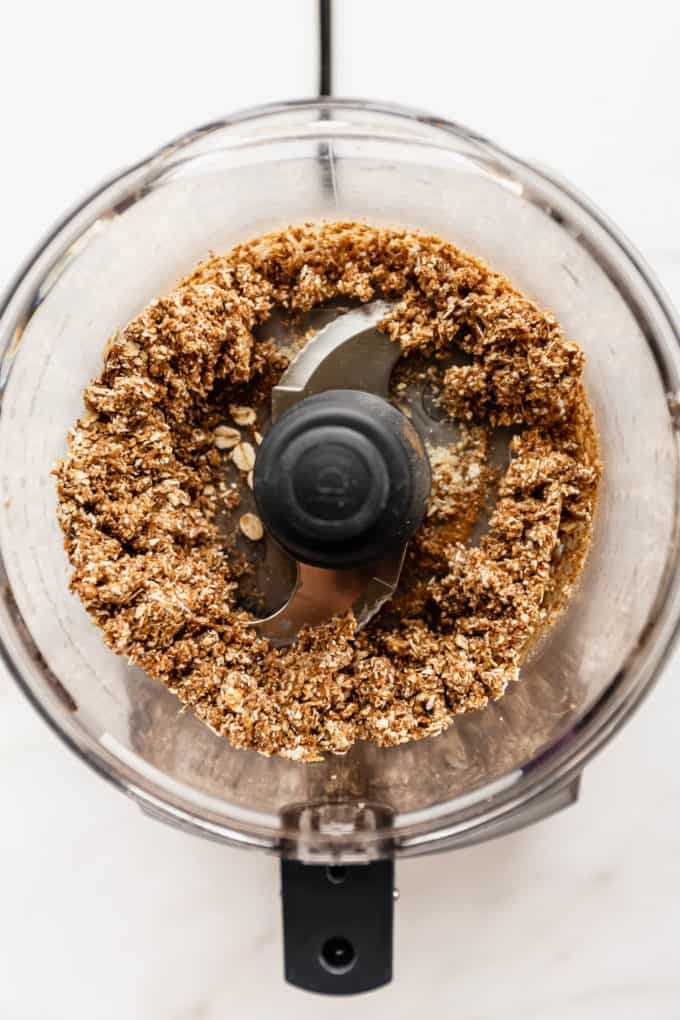 a food processor with blended crisp topping in it