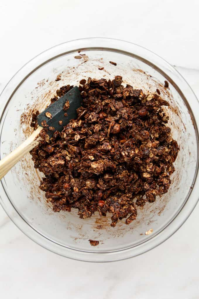 unbaked chocolate granola in a mixing bowl