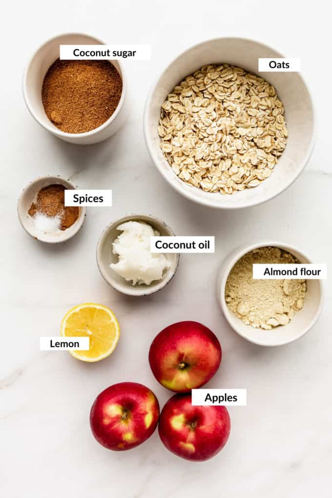 A flat lay of ingredients for healthy apple crisp