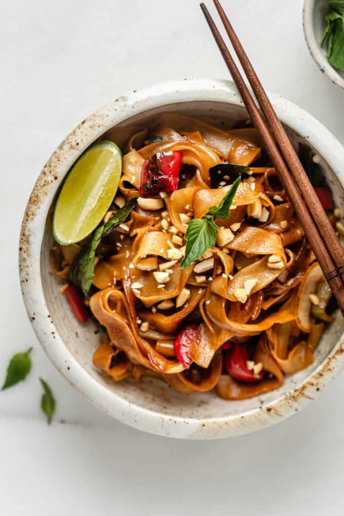 A bowl of Thai drunken noodles with chopsticks