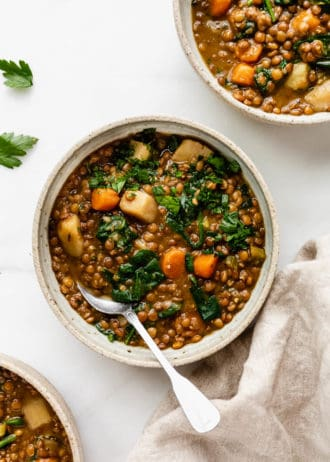 bowls of lentil stew on a white counter