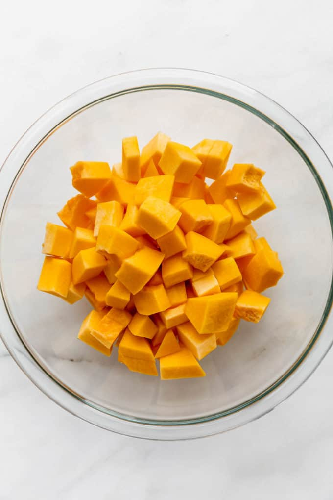 cubes of pumpkin in a clear mixing bowl