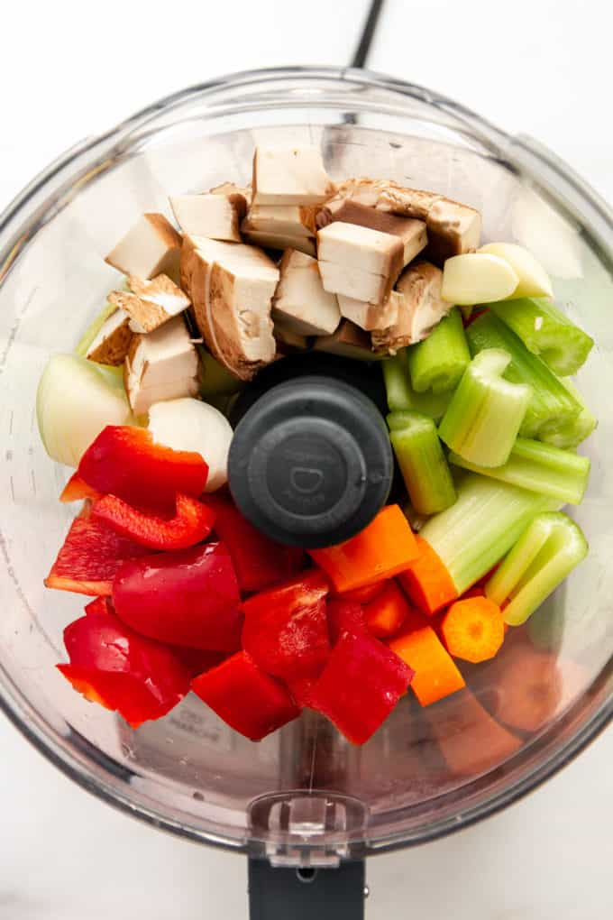 peppers, carrots, celery, onions, garlic and mushrooms in a food processor