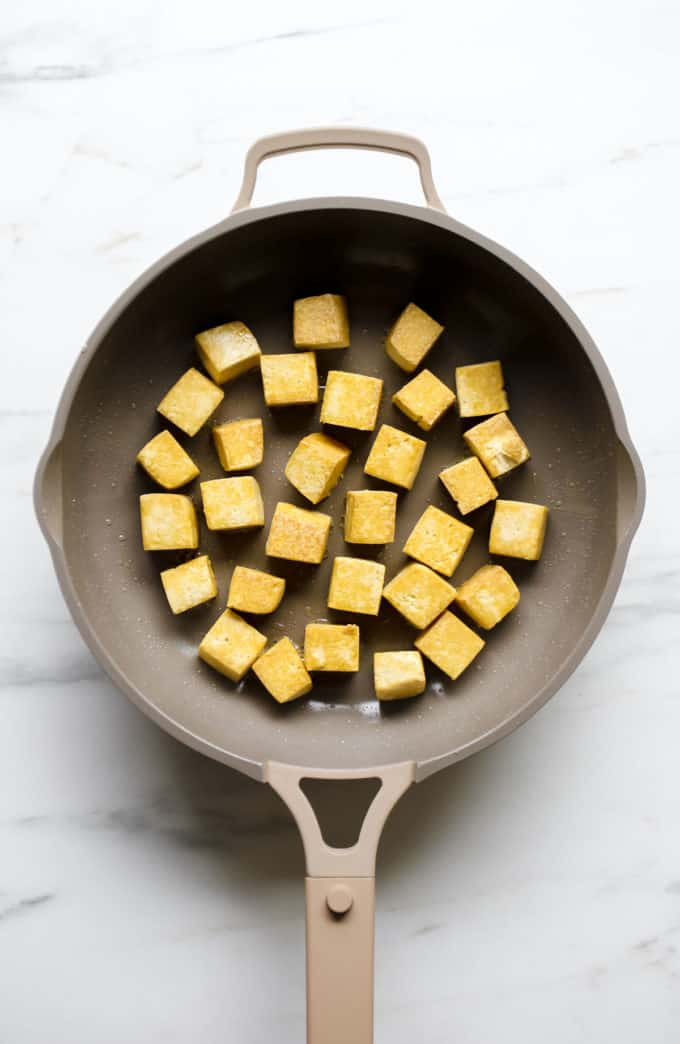 cubes of tofu in a frying pan