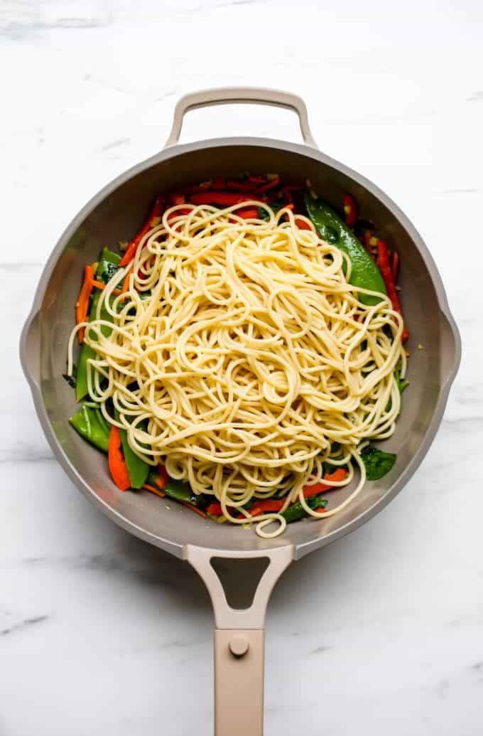 A pan with noodles and vegetables in it