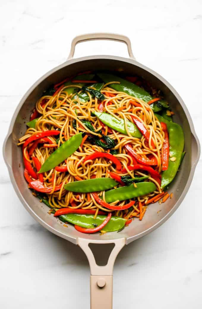 A pan with vegetable lo mein in it